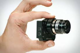 Small camera being held in a hand